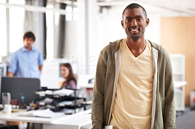 Buy stock photo A handsome indian man standing in the office alongside copyspace
