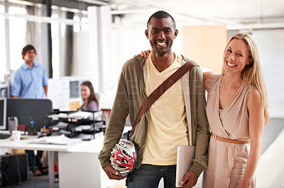 Buy stock photo Two friendly business colleagues standing together in the office