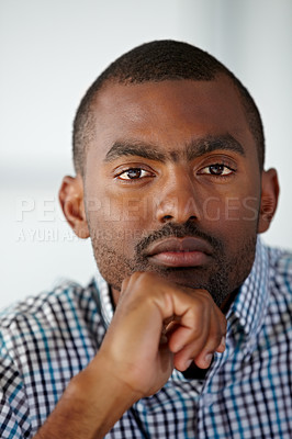 Buy stock photo Portrait of a serious African American man thinking while against a white background