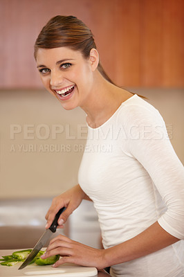 Buy stock photo Portrait of a beautiful young woman cooking in the kitchen