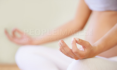 Buy stock photo A cropped image of a pregnant woman meditating