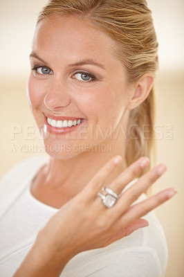 Buy stock photo Portrait of an attractive young woman showing off her engagement ring