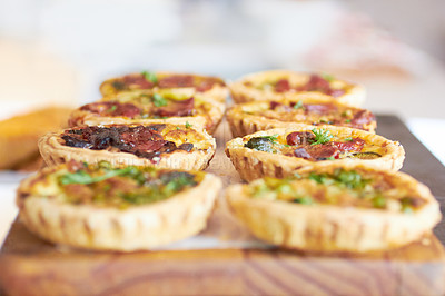 Buy stock photo Cropped shot of a fresh batch of mini quiches