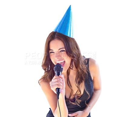 Buy stock photo An attractive young woman singing karaoke while wearing a party hat