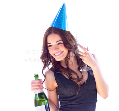Buy stock photo Portrait of an attractive young woman wearing a party hat and holding a bottle