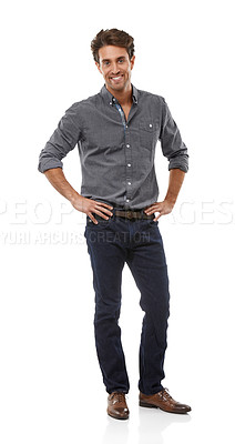 Buy stock photo Full-length portrait of a handsome young man standing with his hands on his hips