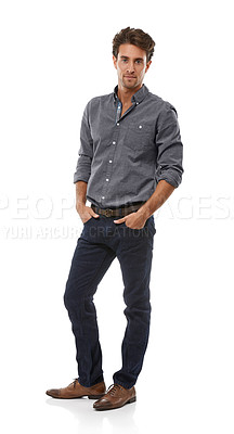 Buy stock photo Full-length portrait of a handsome young man standing with his hands in his pcokets