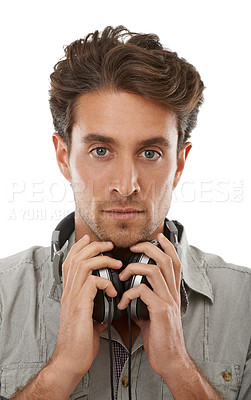 Buy stock photo Portrait of a handsome young man wearing headphones around his neck