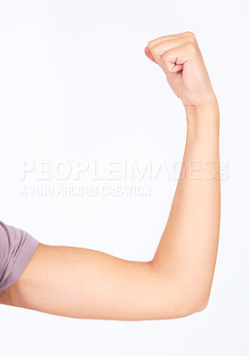 Buy stock photo Cropped image of a young female showing her bicep
