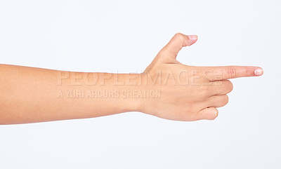 Buy stock photo Cropped image of a hand pointing to the right