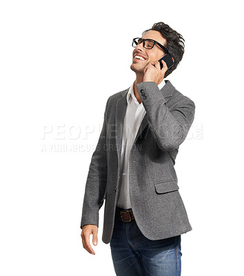 Buy stock photo A handsome young man talking happily on his cellphone