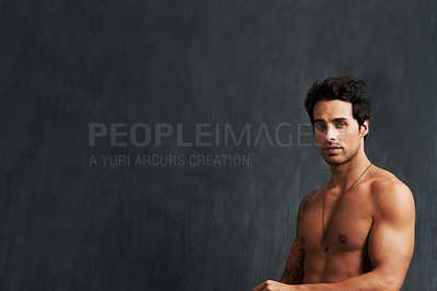 Buy stock photo A shirtless young man standing alongside copyspace