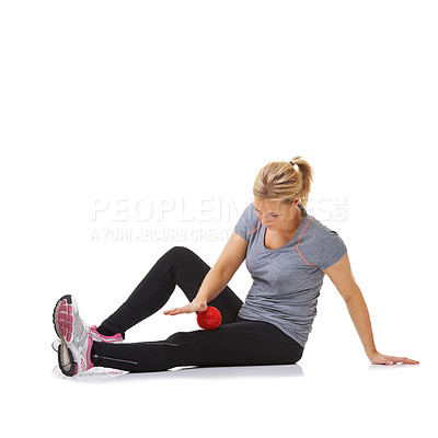 Buy stock photo A young woman using an exercise ball to work out