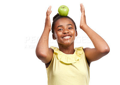 Buy stock photo Studio portrait of a young african american girl balancing an apple on her head isolated on white