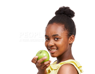 Buy stock photo Portrait of a young african american girl holding an apple isolated on white
