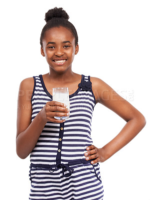 Buy stock photo Studio portrait of a young african american girl drinking a glass of milk isolated on white