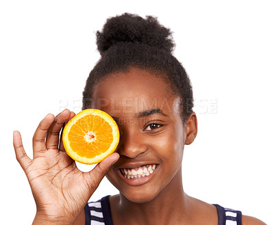 Buy stock photo Studio portrait of a happy young african american girl holding an orange half in front of one eye isolated on white
