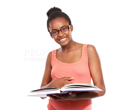 Buy stock photo Studio portrait of a young african american girl reading a book and wearing glasses isolated on white