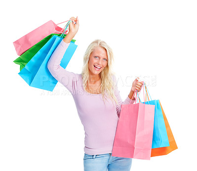 Buy stock photo Portrait of a happy young female holding shopping bags isolated on white