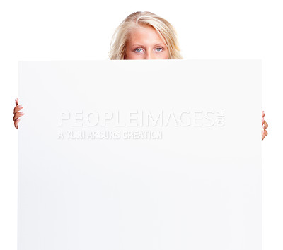 Buy stock photo Portrait of a young woman holding an empty billboard over white background