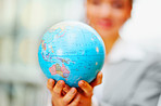 World globe been held by a business woman