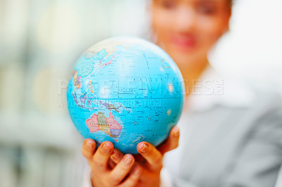 Buy stock photo Business woman holding a globe in the hand, focus on globe
