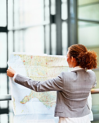 Buy stock photo Rear view of an African American business woman holding a map