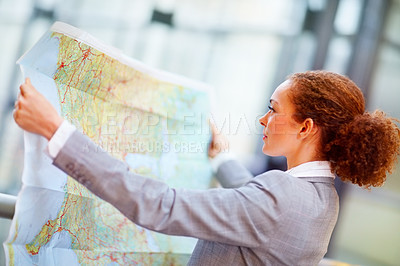 Buy stock photo Young African American business woman going through a geographical map