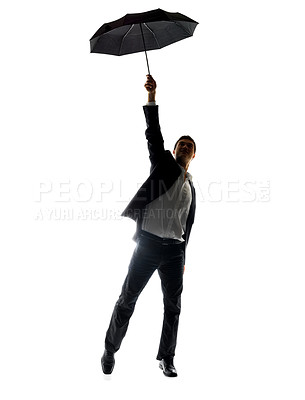 Buy stock photo Portrait of a happy young male entrepreneur holding an umbrella high in air against white background