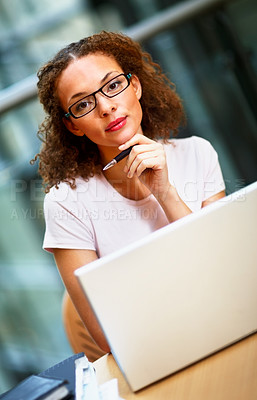 Buy stock photo Cute young African American business woman working on the laptop