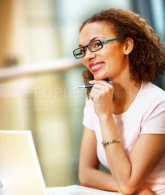Buy stock photo Young African American business woman holding a pen while at work