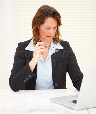 Buy stock photo Mature successful business woman at work , reading her email on the laptop