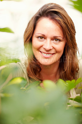 Buy stock photo Closeup portrait of a young woman in her garden, focus on the face