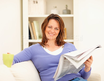 Buy stock photo Beautiful woman at home reading a newspaper and having coffee