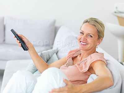 Buy stock photo Portrait of an elderly watching television while at home