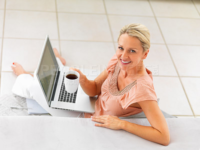 Buy stock photo Top view of happy mature lady working on laptop and enjoying cup of coffee