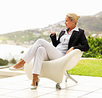 A middle age business woman drinking coffee while relaxing