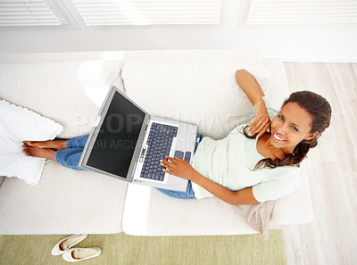 Buy stock photo Top view of an African American woman using laptop in the living room