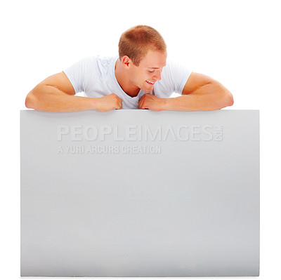 Buy stock photo Portrait of a happy young man with a blank white card