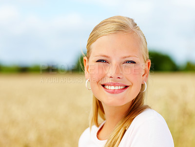 Buy stock photo Closeup of a pretty woman smiling at a field