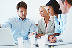 Smart businessman implementing new ideas with associates