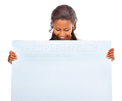 Buy stock photo Portrait of an African American woman looking at an empty billboard over white background