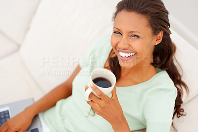 Buy stock photo Top view of an African American lady working on laptop while having tea