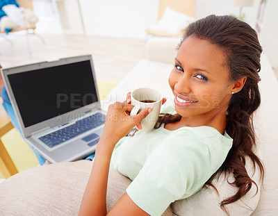 Buy stock photo Top view of cheerful African American lady working on laptop and enjoying cup of coffee