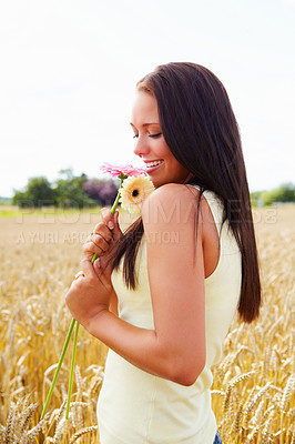 Buy stock photo Portrait of a beautiful young female holding flowers, countryside