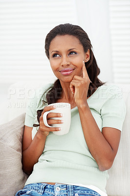 Buy stock photo Sweet African American female having tea at home, lost in thought