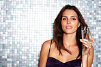 Young female model with wine glass in a disco
