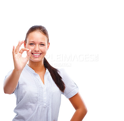 Buy stock photo Beautiful young female showing an OK sign isolated over white