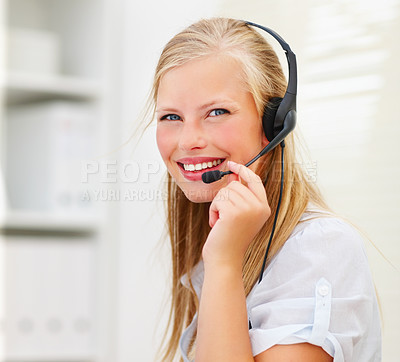 Buy stock photo A beautiful young woman wearing headphones in office