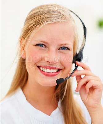 Buy stock photo Closeup portrait of a happy young call centre employee at work